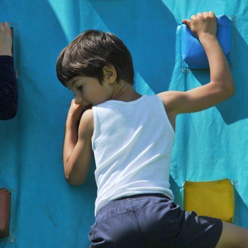 A child enjoying the climbing wall