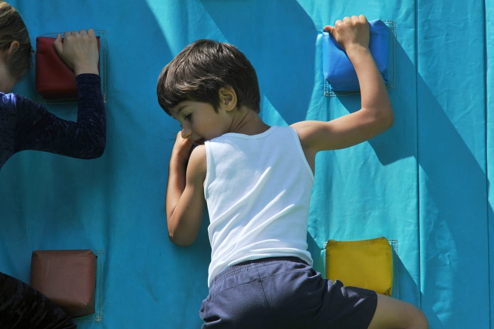 A child enjoying the climbing wall