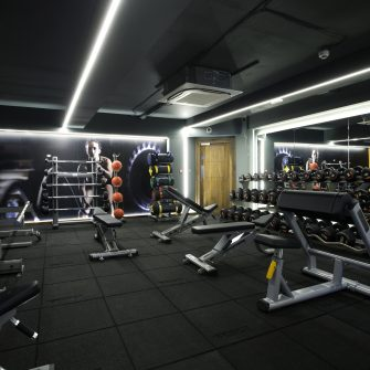 Benches and dumbells weights at the Core Gym at the Alex Hotel
