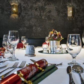 Table decorated for Christmas dinner at The Alex Hotel