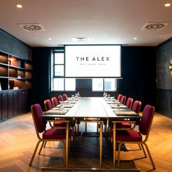 A meeting room set up at the Alex Hotel