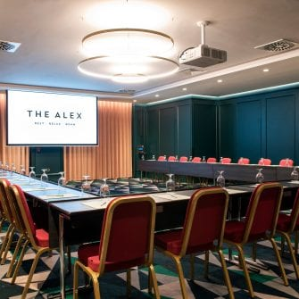 The screen set up for a meeting at The Alex Hotel
