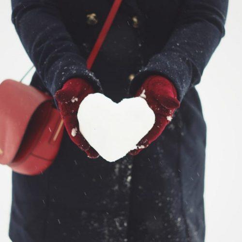 A women enjoying the snow outside The Alex Hotel